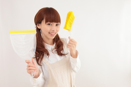 Young Asian woman with a cleaning tool Stock Photo - 11322695