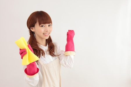 Young Asian woman with a cleaning tool photo