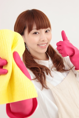 housewife gloves: Young Asian woman with a cleaning tool Stock Photo