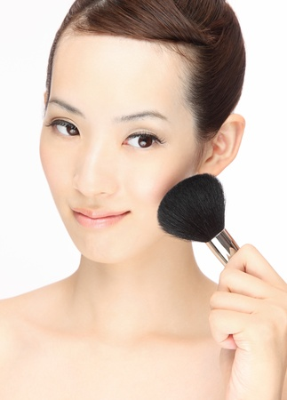 brush in: Beautiful Young Asian woman makeup