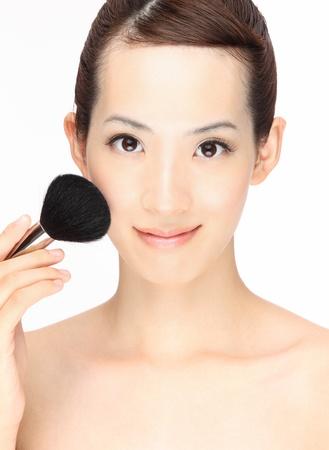 brush in: Beautiful Young Asian woman makeup