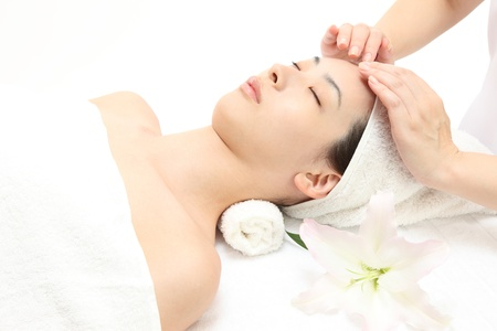 Young Asian woman to head massage photo