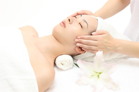 Young Asian woman to face massage