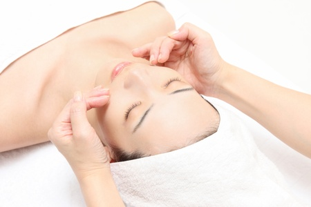 face massage: Young Asian woman to face massage