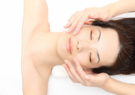 Young Asian woman to face massage photo
