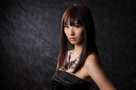 アジア系の若いモデル黒背景 写真素材