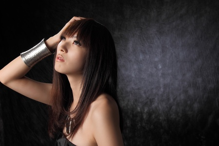 Young Asian model black background photo