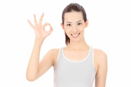 OK hands to make young asian women photo