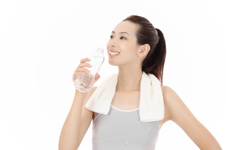 Beautiful young Asian woman with water photo
