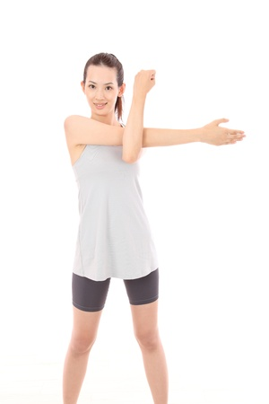 Beautiful young Asian woman stretch  photo