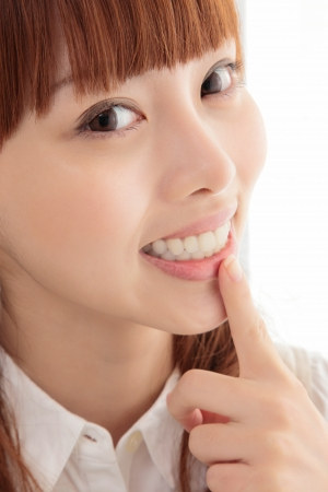 Young Asian women white teeth photo