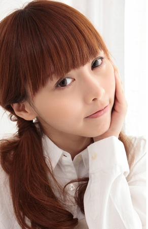 Young Asian woman with toothache Stock Photo - 11700308