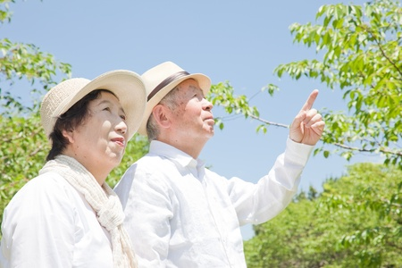 Pointing to an elderly couple