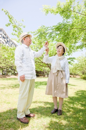 Pointing to an elderly couple photo