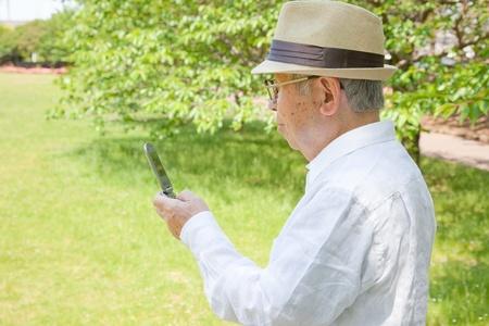 More elderly Asian mobile phone photo