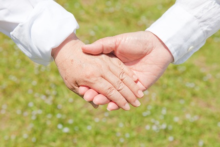 An old couple holding hands Stock Photo