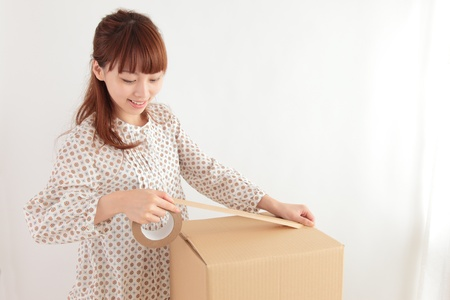 Young Asian woman in a cardboard packing