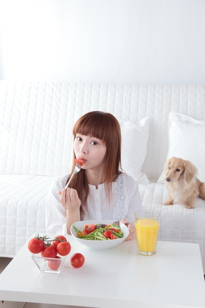 Beautiful young Asian woman to eat vegetables Stock Photo - 12413325