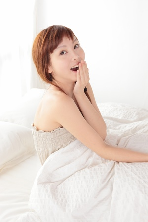 Beautiful young Asian woman on the bed photo