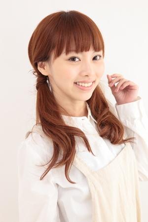 Beautiful young Asian woman wearing an apron Stock Photo