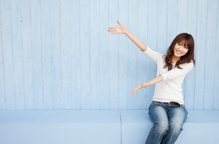 to raise: Young Asian woman holding hands with space for copy Stock Photo