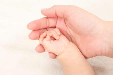 margins: Asian parents and children hold hands in white background