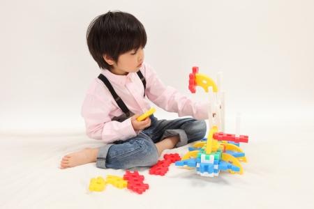 Asian boys play with toys