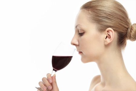 Beautiful young caucasian women smell the wine photo