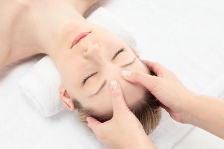 Young Caucasian woman facial massage