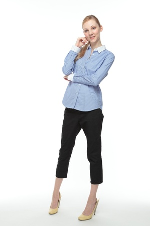 the whole body: Beautiful smiling young Caucasian woman white background Stock Photo