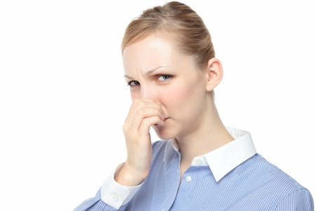 hatred: Young woman pinch the nose white background