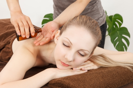ayurvedic: Relaxed woman receiving back massage at spa