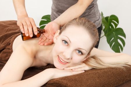 esthetics: Relaxed woman receiving back massage at spa