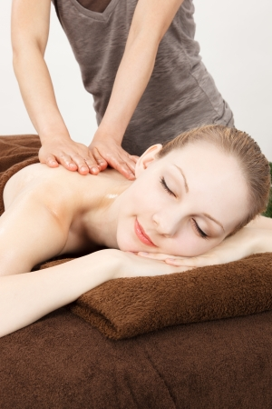 esthetician: Relaxed woman receiving back massage at spa