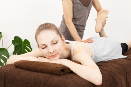 alternative therapies: Caucasian woman undergoing a chiropractic Stock Photo