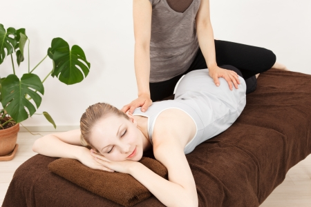 osteopathy: Caucasian woman undergoing a chiropractic Stock Photo