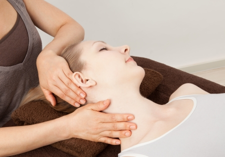 Beautiful young caucasian woman undergoing a massage Stock Photo - 14552860