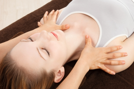 healing touch: Beautiful young caucasian woman undergoing a massage Stock Photo