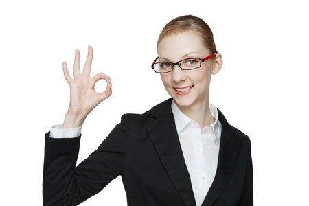 Beautiful young caucasian woman to make a finger with white background photo