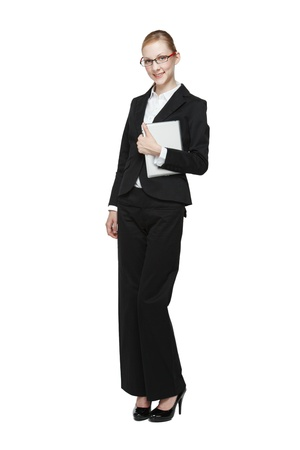 pantsuit: Young smiling businesswoman wearing black dress and high heels. Stock Photo