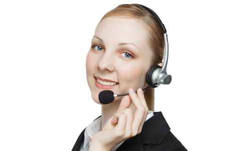 Attractive young businesswoman with headset, white studio background. photo