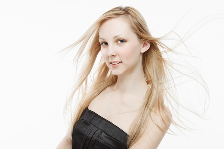 Beautiful young blond woman smiling , white studio background photo
