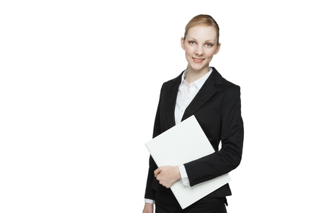Businesswoman with blank white sign under arm, studio background. photo