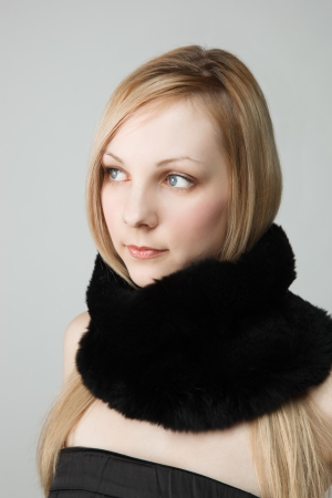 Portrait of woman with long black scarf, studio background Stock Photo - 15201908