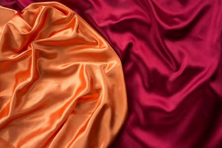 Smooth elegant orange and dark red silk can use as background photo