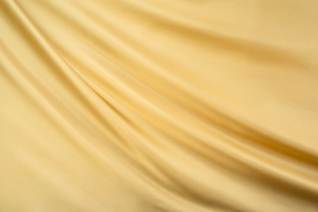 滑らかなエレガントなゴールドのシルクの背景として使用することができます。
