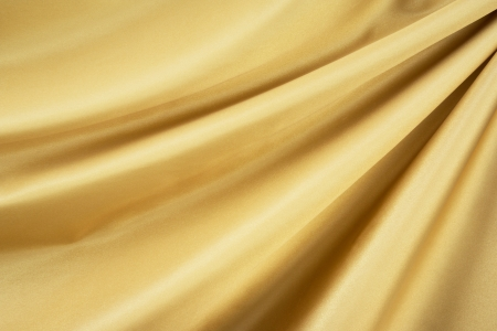 draped: Smooth elegant gold silk can use as background