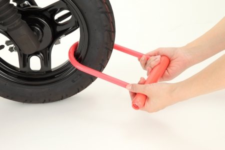 theft prevention: Key attached to a motorcycle tire