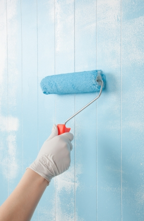 Painting a wall in blue photo