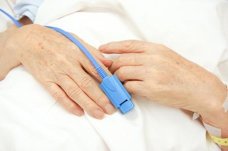 finger tip: Pulse oxymeter at finger tip Stock Photo